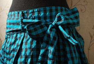 С чем носить юбку в клетку? Простые и сложные комбинации